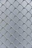 Eisendrahtzaun-Vertikalenhintergrund lizenzfreie stockbilder