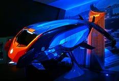 Eisenflügelkennzeichen viii, fliegender Personenkraftwagen, Eisenmann-Erfahrungsanzeige bei Disneyland, Hong Kong lizenzfreie stockfotos