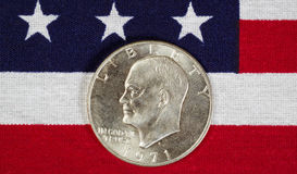 Eisenhower Silver Dollar on American Flag. Closeup view of United States Silver Dollar Coins, President Eisenhower, placed on American Flag stock image