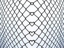 Eisenstange mit reizender kleiner Herzformbiegung für abstraktes backgro Lizenzfreies Stockfoto