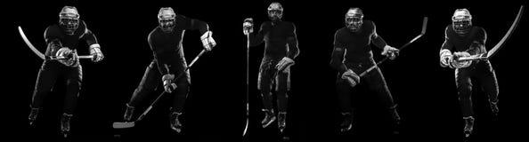 Eishockeyspielermann in der Maske und Handschuhe auf schwarzem Hintergrund mit Stock lizenzfreies stockbild