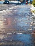Eisiger Bürgersteig Stockbild