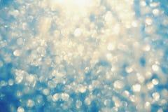 Eisiger bokeh Funkelnschein-Zusammenfassungshintergrund Stockbilder