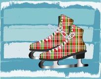 Eisiger Hintergrund des Winters mit Plaid iceskates Stockfotografie