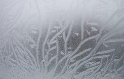 Eisiges Muster auf dem Fenster Lizenzfreies Stockfoto
