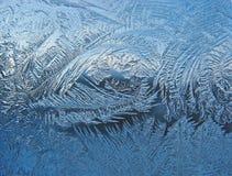 Eisiges Muster auf Scheibe Stockbilder