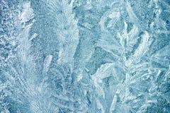 Eisiges Muster des Hintergrundes auf Glas Stockbild