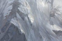Eisiges natürliches Muster auf Winterfenster Lizenzfreies Stockfoto