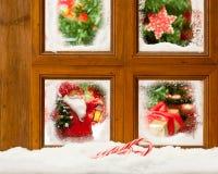 Eisiges Weihnachtsfenster Stockfotos