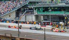 EJ Viso, Tony Kanaan, and Helio Castroneves entering the pit. Royalty Free Stock Images