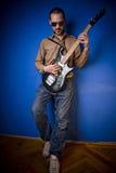 Eje de balancín con la guitarra Imagen de archivo libre de regalías