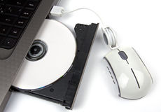 Eject Cd. White cd, laptop and white mouse Stock Photography