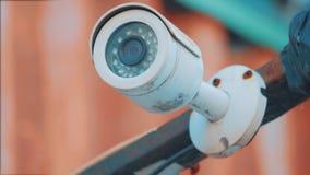 Ejecución al aire libre de la cámara de vigilancia afuera cámara de seguridad y protección video urbana de la vigilancia contra h almacen de video
