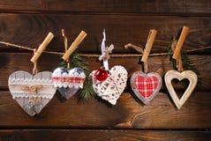 Ejecución de la colección de los corazones de la Navidad en la guita Fotografía de archivo libre de regalías