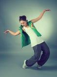 Ejecución femenina del salto de la cadera Imagenes de archivo