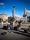 Ejecutantes de la calle en Trafalgar Square fotos de archivo