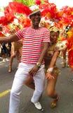 Ejecutantes del carnaval de Notting Hill que bailan Londres, Inglaterra Imágenes de archivo libres de regalías