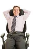 Ejecutivo feliz en silla ergonómica Imagen de archivo libre de regalías