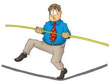 Ejecutivo que recorre una cuerda de volatinero. Imagen de archivo libre de regalías