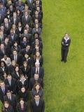 Ejecutivos de By Group Of de la empresaria en fila Fotografía de archivo