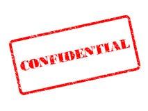 Ejemplo confidencial del sello de goma en el fondo blanco Imagen de archivo libre de regalías