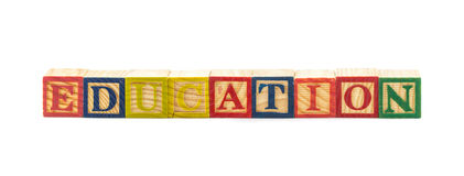 ejemplo 3d de la educación de la palabra usando los cubos coloridos Foto de archivo libre de regalías