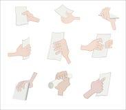 Sistema de la mano que sostiene el papel Fotos de archivo