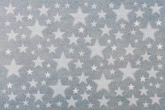 Ejemplo de estrellas en el dril de algodón azul imágenes de archivo libres de regalías