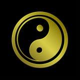 Ejemplo de Jin Jang metálico de oro, fondo negro Fotografía de archivo