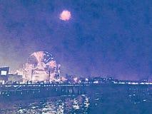 Ejemplo de la acuarela de Santa Monica Pier en la noche Imagen de archivo