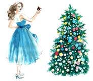Ejemplo de la acuarela de una mujer con una bola que adorna un árbol de navidad aislado en el fondo blanco stock de ilustración