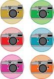 Ejemplo de la cámara de SLR en los diversos colores/color Imágenes de archivo libres de regalías
