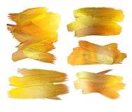 Ejemplo de la mancha de la pintura de la textura del oro Elemento dibujado mano del diseño del movimiento del cepillo Foto de archivo
