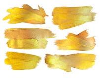 Ejemplo de la mancha de la pintura de la textura del oro Elemento dibujado mano del diseño del movimiento del cepillo Fotografía de archivo