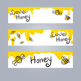 Ejemplo de la miel y de la abeja Fotografía de archivo