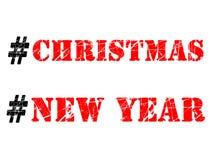 Ejemplo de los hashtags de la Navidad y del Año Nuevo en el fondo blanco fotos de archivo libres de regalías