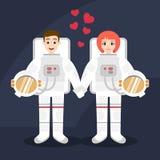 Ejemplo de los pares de los astronautas en el amor que lleva a cabo las manos Imagen de archivo