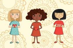 Ejemplo de muchachas multiculturales con los corazones Imagen de archivo