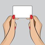 Ejemplo de PopArt de una mano con una tarjeta de visita Foto de archivo libre de regalías