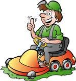 ejemplo de un jardinero feliz que monta su lawnm Imagen de archivo libre de regalías