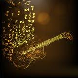 Ejemplo de una guitarra de oro con las notas musicales Imágenes de archivo libres de regalías