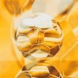 Ejemplo del balón de fútbol del oro ilustración del vector