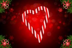 Ejemplo del bokeh de la Navidad con las barras de caramelo que forman un corazón y un abeto de la esquina adornados stock de ilustración