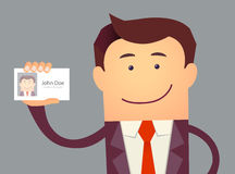 Ejemplo del hombre de negocios que celebra la tarjeta en blanco de la identificación Fotografía de archivo libre de regalías