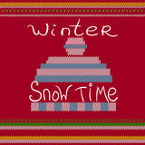 Ejemplo del sombrero del invierno en fondo hecho punto de la materia textil Imagen de archivo libre de regalías