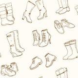 Ejemplo del vector de los zapatos de la caída y del invierno de la mujer, botas fijadas Modelo inconsútil Fotos de archivo libres de regalías