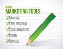 Ejemplo en línea de la marca de verificación de las herramientas de márketing Foto de archivo libre de regalías