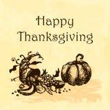 Ejemplo feliz del día de la acción de gracias Garabatee la calabaza y la cornucopia dibujadas mano, fondo amarillo de la acuarela Foto de archivo