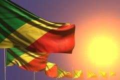 Ejemplo hermoso de la bandera 3d del día del himno - muchas banderas de Congo colocaron diagonal en puesta del sol con el lugar p stock de ilustración