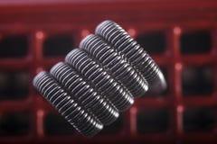 Ejemplo vaping torcido de las bobinas del filamento multi Imagenes de archivo